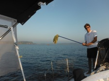 Approaching Tenacatita - Will does a morning mop wiith the dew that settles on the decks
