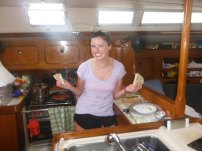 Katy cooking in the galley