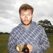 Will on the golf course - that cold beer isn't going to warm you up!